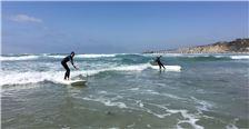 Kids surfing the ocean