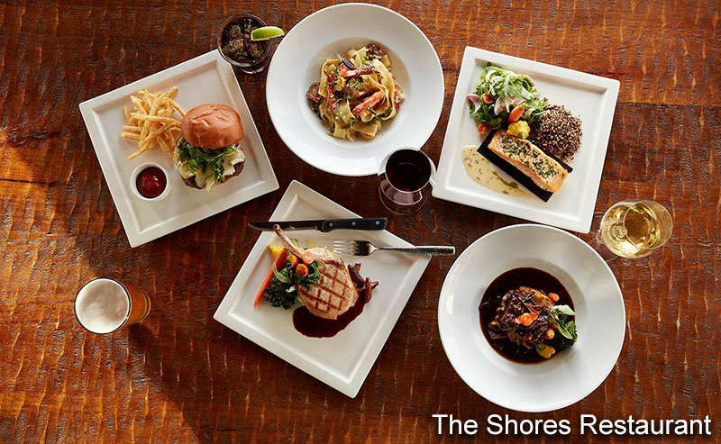 Five plates of dinner options from the Shore Restaurant, inclding a hamburger, a pasta dish, a salmon filet, a pork chop, and a beef entree.