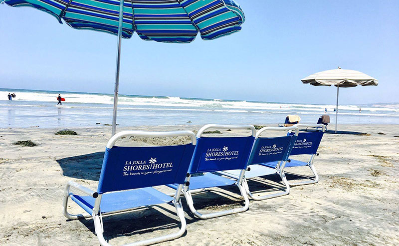 La Jolla Shores Hotel's beachchairs set up on the beach with a sun umbrella