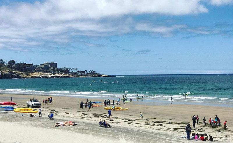Swimmers, Sunbathers, and Kayks on the La Jolla Shores Beach