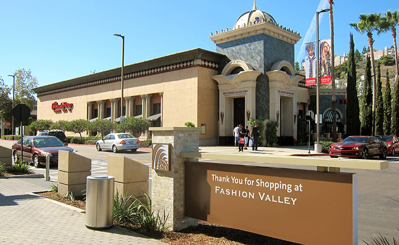 View of the two-story interior of Fashion Valley Mall that has two elevators located in the middle of the outdoor shopping mall.