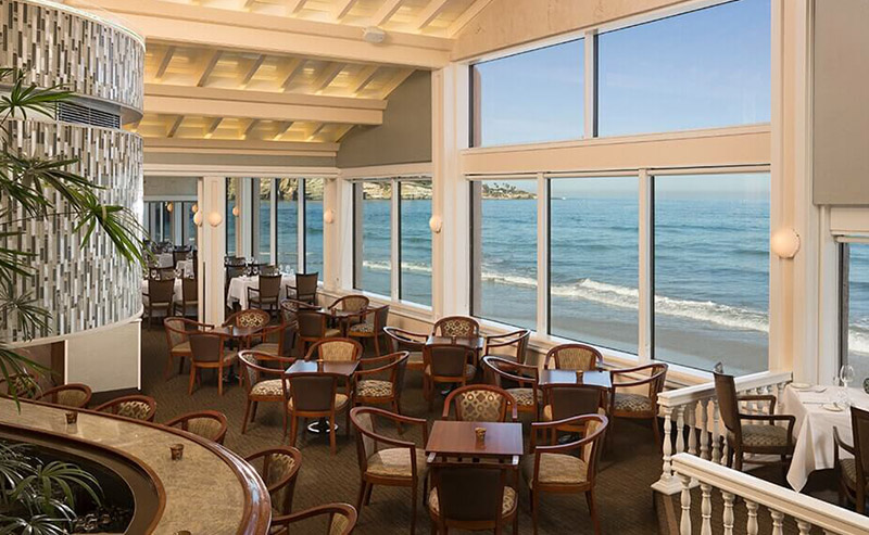 Table and chairs set for the night at The Marine Room in La Jolla Shores Hotel.