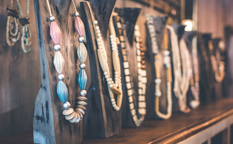 A display of handmade jewelry at a local boutique.