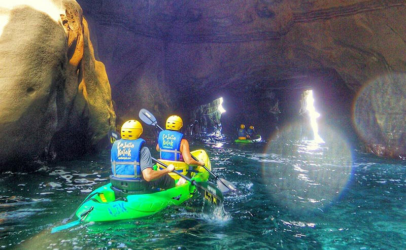 Kayakers paddling through the La Jolla Sea Caves