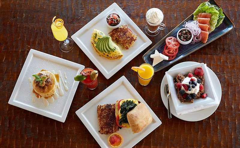 Overhead view of a variety of plated foods at La Jolla Shores restaurant