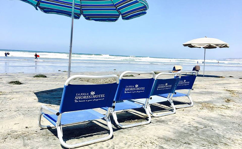 Complimentary beach chairs and umbrella set up at La Jolla Shores Hotel