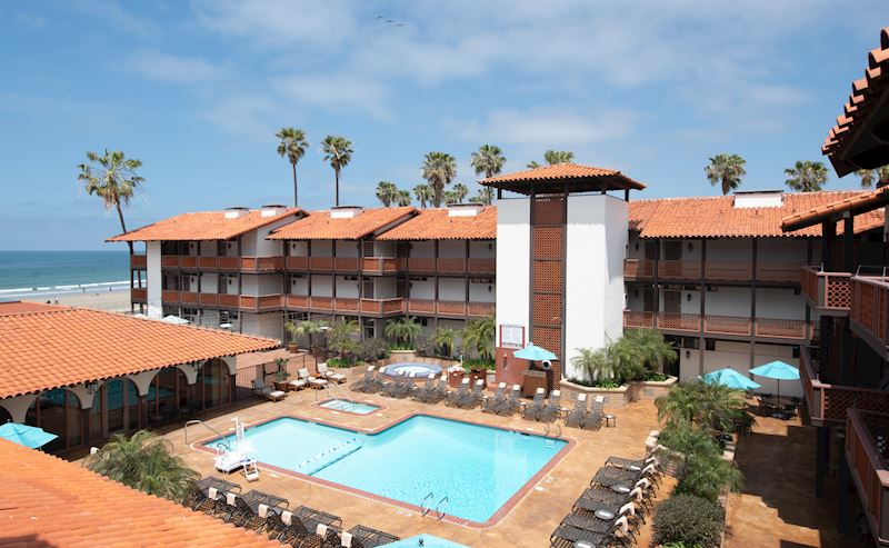 La Jolla Shores Hotel heated pool with lounge chairs surrounding