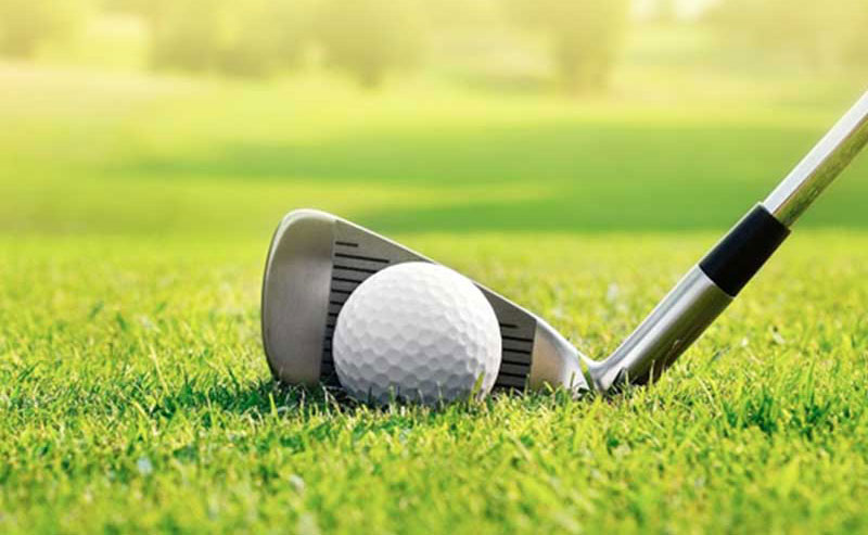 A close up shot of a golf club ready to hit the ball at Torrey Pines Golf Course in La Jolla