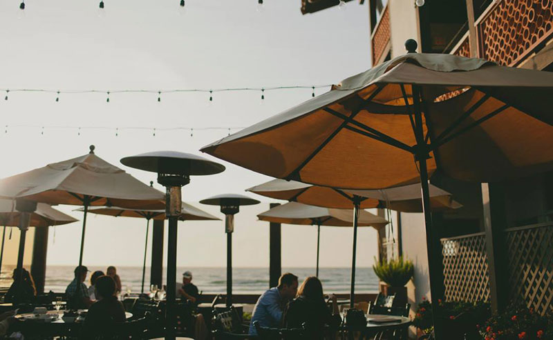 People enjoying a meal on the La Jolla Shores patio