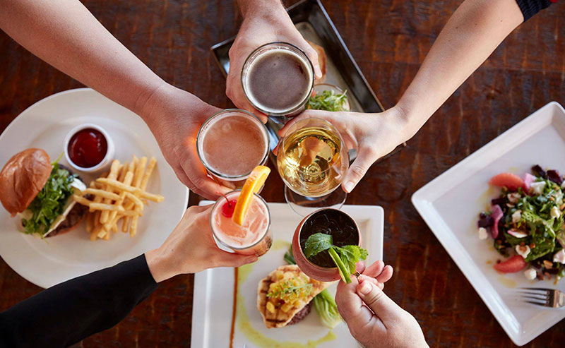 People toasting over happy hour at La Jolla Shores Hotel