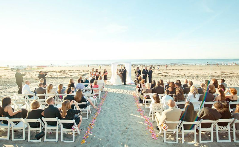 A couple getting married on the beach at La Jolla Shores Hotel