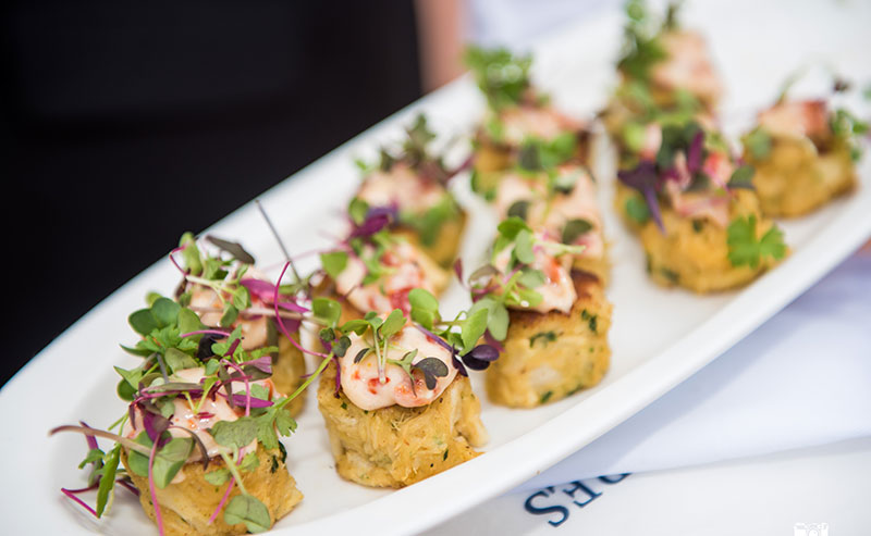 A plate displaying crab cakes as an appetizer for a wedding at La Jolla Shores Hotel
