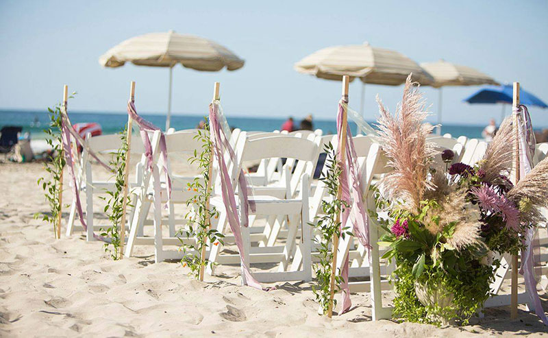 Wedding chairs set up at a beach wedding at La Jolla Shores Hotel