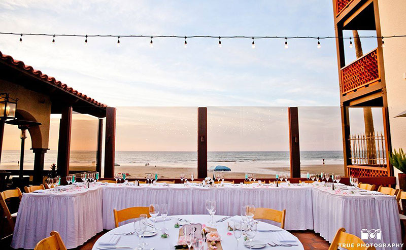 Wedding party table setup on the Shores Patio at La Jolla Shores Hotel