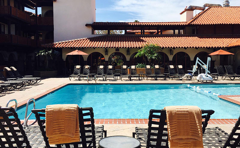 La Jolla Shores Hotel heated pool with loung chairs surrounding it