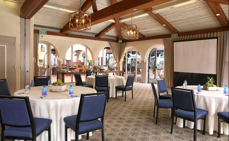 Tables and chairs set up for a meeting in one of the meeting rooms at La Jolla Shores Hotel