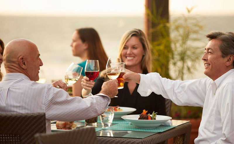 Three professionals toasting over a business meeting at the La Jolla Shores restaurant