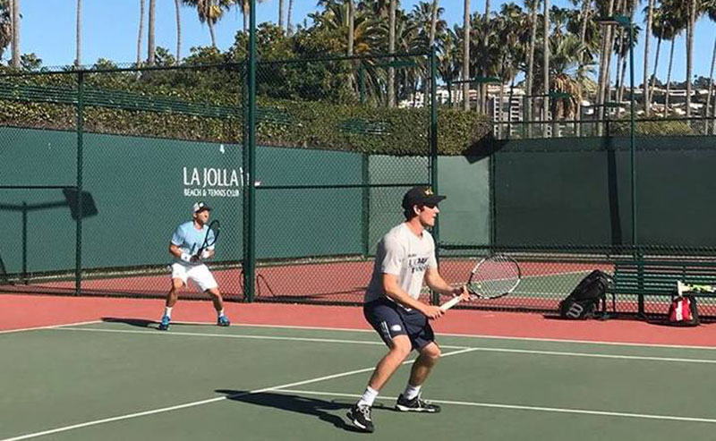 Two men playing tennis at the La Jolla Beach and Tennis Club courts