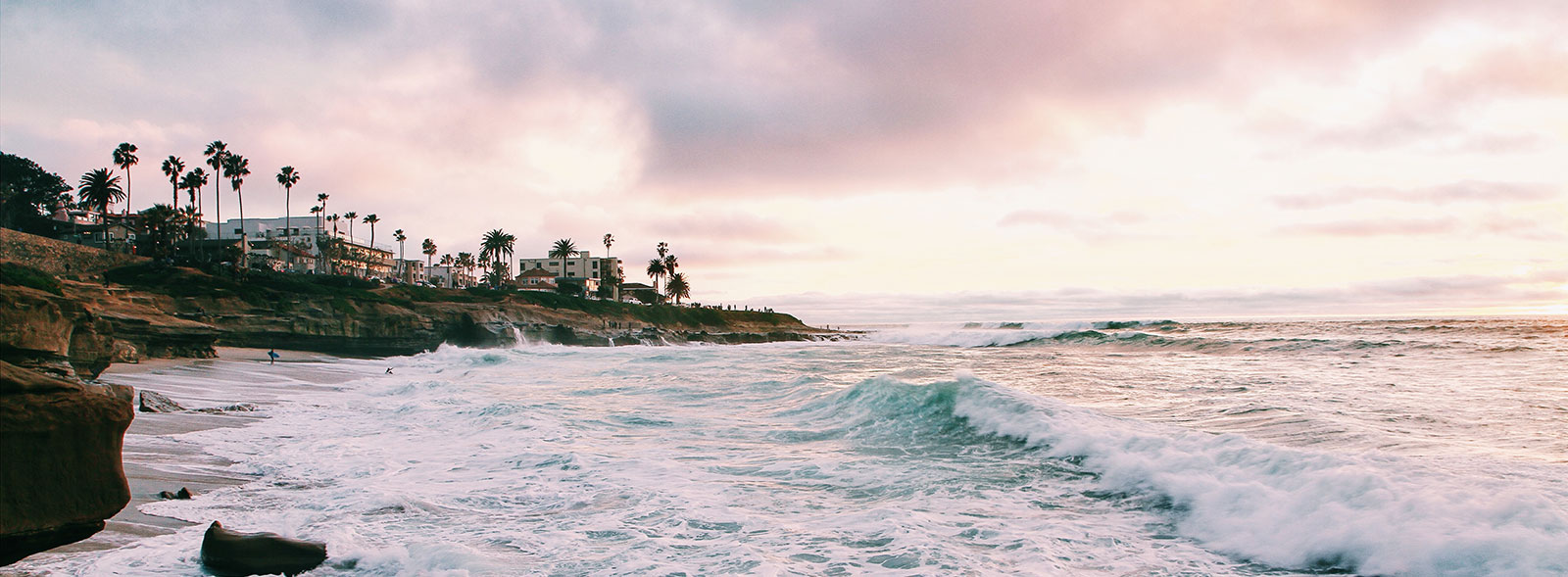 Waves breaking on the La Jolla Shores coast during sunset
